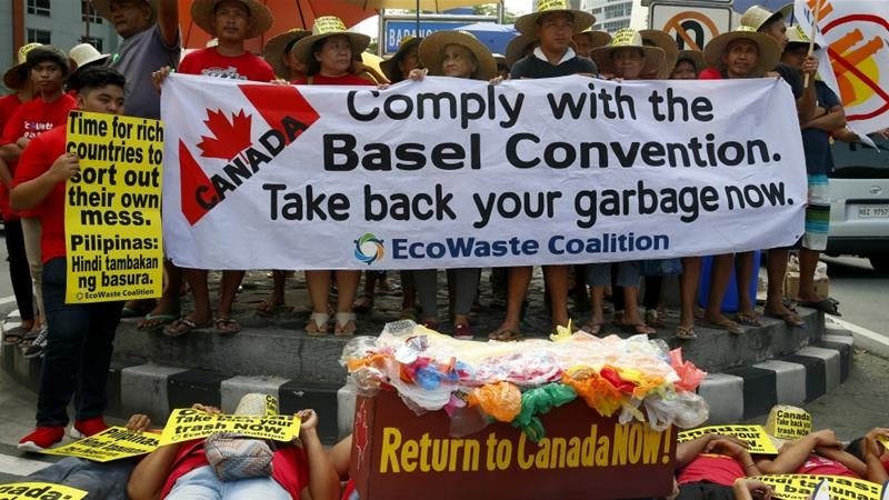 Environmentalists stage a protest outside the Canadian Embassy in Manila [Bullit Marquez/AP Photo]