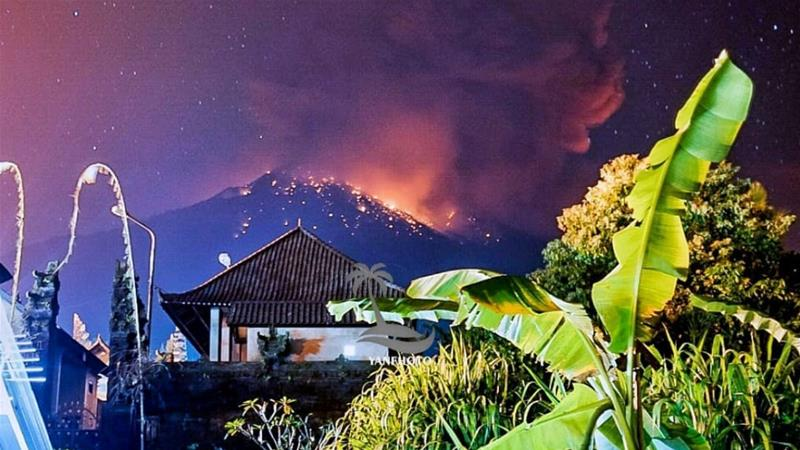 Thick smoke and glow from lava are seen as Mount Agung volcano erupts in Karangasem Regency, Bali [Wayan Kartika/Reuters]