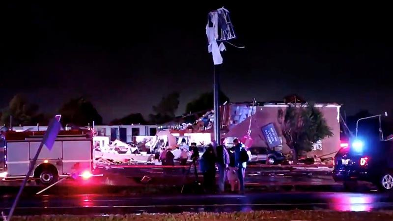Emergency vehicles sit near a partially collapsed hotel after a tornado touched down in El Reno, Oklahoma [Gale Vancampen/Reuters]