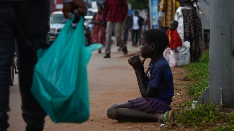 Last week, the city of Kampala passed a law that forbids giving alms to street children [Isaac Kasamani/Al Jazeera]
