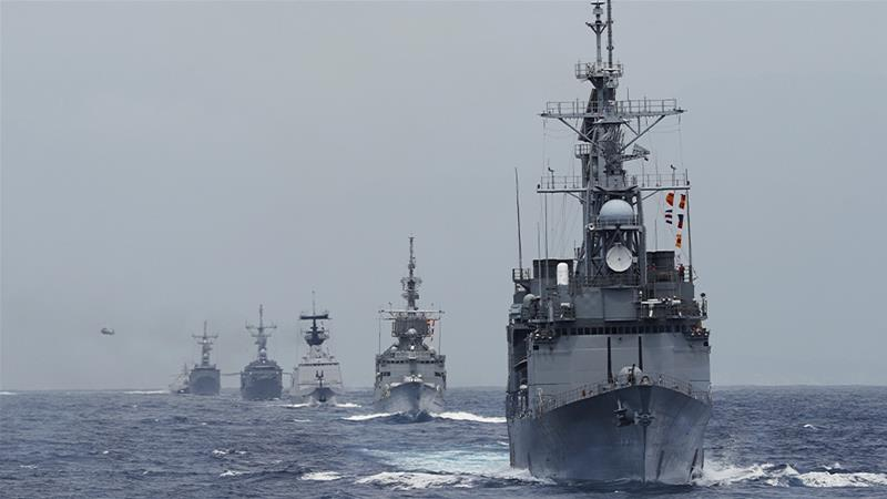 The destroyer Kee Lung and navy vessels taking part in a military drill in the seas off Taiwan on May 22 [Tyrone Siu/Reuters]