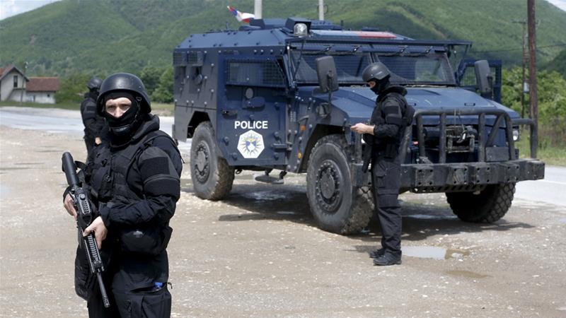Kosovo police special unit members secure the area near the village of Cabra in northern Kosovo [Visar Kryeziu/AP]