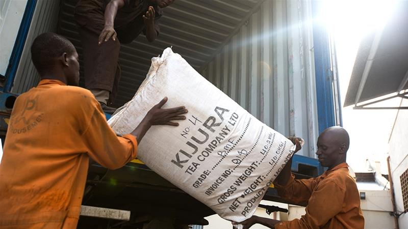 Two of Kenya's 'Big Four' priorities are raising farmer incomes and increasing the country's affordable housing stock.  Workers unloading tea from a port warehouse in Mombasa, Kenya: [Trevor Snapp/Bloomberg]