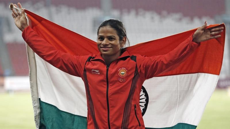 Indian athlete Dutee Chand poses with her national flag after winning a silver medal at the 2018 Asian Games in Jakarta on August 26, 2018  [File: Reuters/Darren Whiteside]