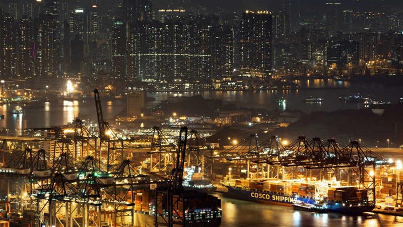 Container ships sit moored at Kwai Tsing Container Terminal in Hong Kong [Bloomberg]