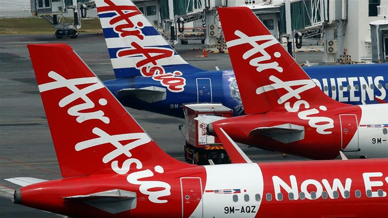 Budget airline AirAsia wants to enhance its passenger experience [Edgar Su/Reuters]