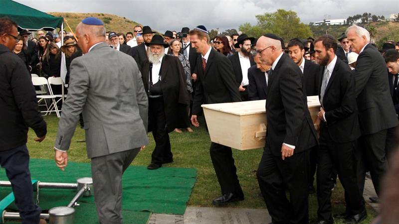 A casket with the body of Lori Gilbert-Kaye, killed in the April 27 synagogue shooting in Poway, is carried at El Camino Memorial cemetery in San Diego, California on April 29 [John Gastaldo/Reuters]