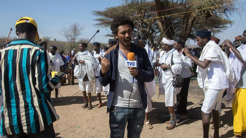 An Ethiopian journalist during the Gada system ceremony in Borana tribe, Oromia, Yabelo on March 7, 2017 [Eric Lafforgue/Art In All Of Us/Corbis via Getty Images]