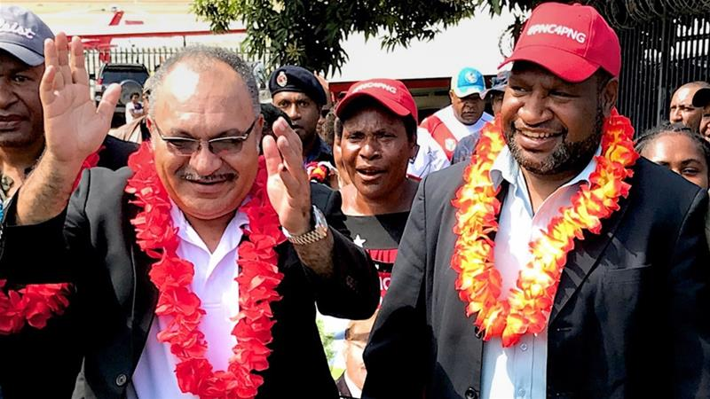 Peter O'Neill, left, and his then-Finance Minister James Marape pictured in Port Moresby in 2017 [File: AFP]