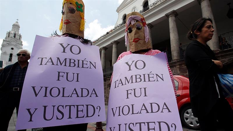 Women hold banners that read in Spanish: 'I too was raped. And you?,' during a demonstration marking the Day of No Violence Against Women in Quito, Ecuador [File: Dolores Ochoa/AP Photo]