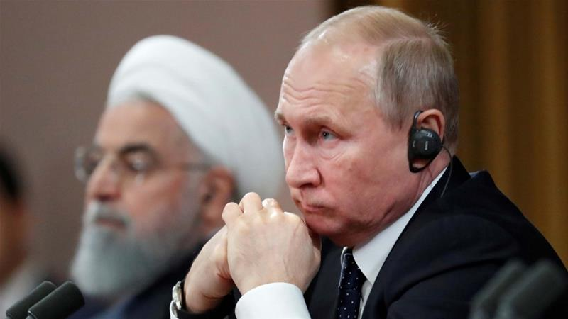 Russian President Vladimir Putin and Iranian President Hassan Rouhani attend a news conference, after a meeting in the Black sea resort of Sochi on 14 February, 2019 [File: Reuters/Sergei Chirikov]