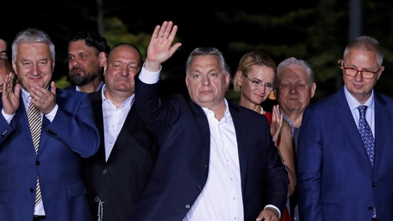 Hungarian Prime Minister Viktor Orban waves after addressing supporters, following the preliminary results of the European Parliament election in Budapest on May 26, 2019 [Reuters/Bernadett Szabo]
