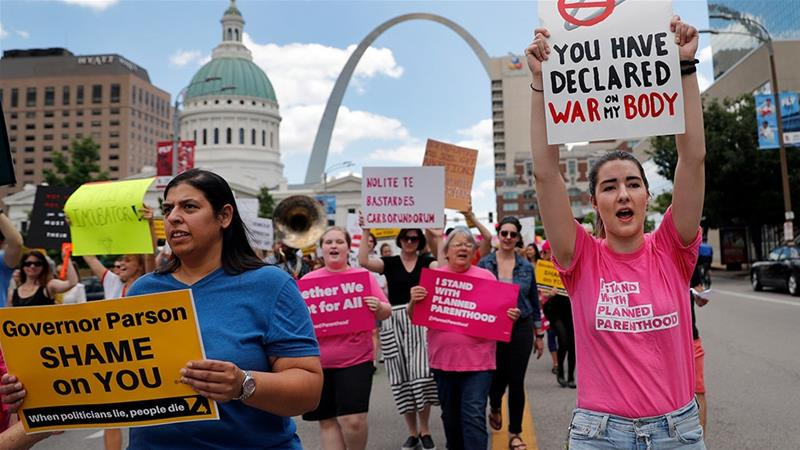 Abortion-rights supporters march in St. Louis [Jeff Roberson/AP Photo]