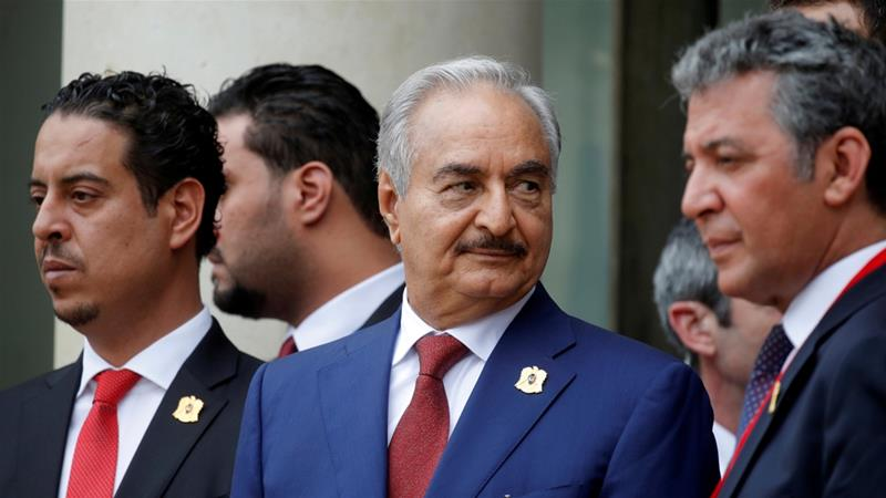 Khalifa Haftar,centre, the renegade military commander who dominates eastern Libya, leaves an international conference on Libya at the Elysee Palace in Paris, France, May 29, 2018 [File: Philippe Wojazer/Reuters]