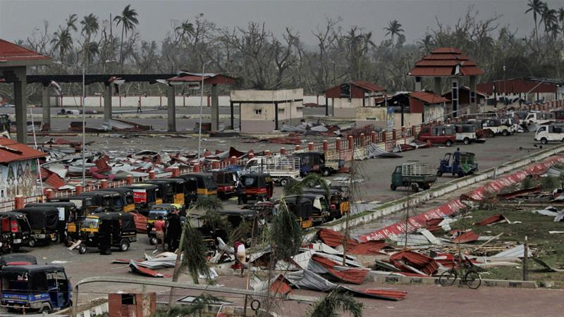 Corrugated sheets used as roofing lie scattered after Cyclone Fani made landfall in the Penthakata fishing village of Puri  [AP]
