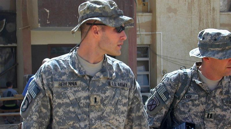 In this Sunday, Sept. 21, 2008, file photo, 1st Lieutenant Michael C Behenna, left, and his defence lawyer Tom Clark, right, walk in Camp Speicher, a large US base near Tikrit, north of Baghdad, Iraq [File: Vanessa Gera/AP Photo]