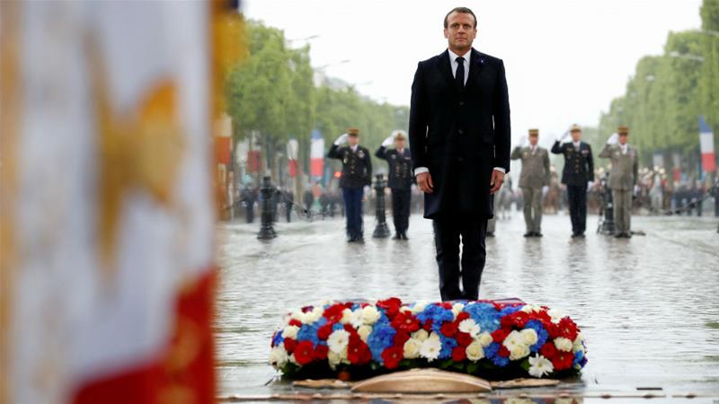 President Emmanuel Macron lays a wreath marking the 74th anniversary of World War II's end in Europe [Christian Hartmann/AFP]