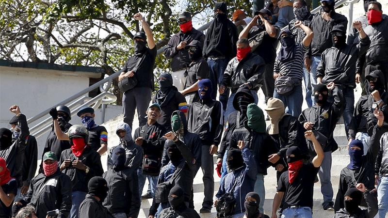 Members of a armed grassroots groups, called 'colectivos' are seen outside Miraflores Palace in Caracas, Venezuela in January 2016 [File: Christian Veron/Reuters]