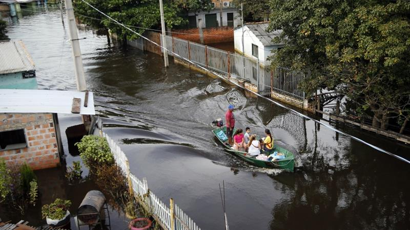 Officials in Paraguay say they evacuated some 40,000 people in recent weeks because of flooding [Jorge Saenz/AP]