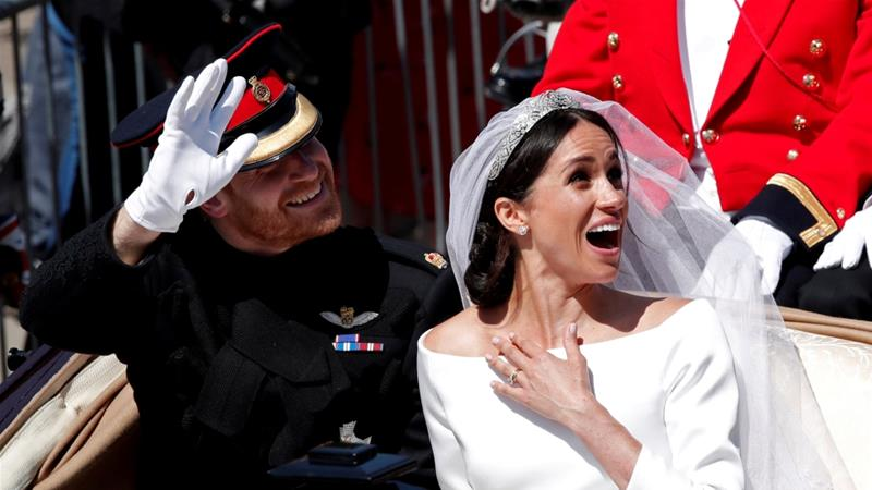 Britain's Prince Harry and his wife Meghan ride a horse-drawn carriage after their wedding ceremony at St George's Chapel in Windsor Castle in Windsor, UK, May 19, 2018 [File: Benoit Tessier/Reuters]