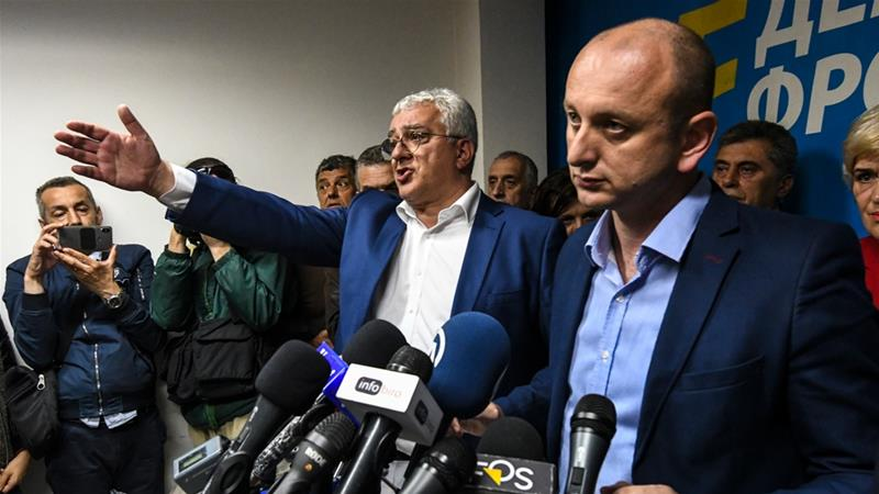Montenegro opposition leaders Andrija Mandic and Milan Knezevic attend a news conference after being convicted by a Montenegrin court [Savo Prelevic/AFP]