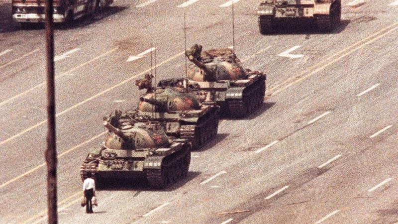 A man stands in front of a convoy of tanks in Tiananmen Square in Beijing on June 5, 1989 [REUTERS/Arthur Tsang/files]
