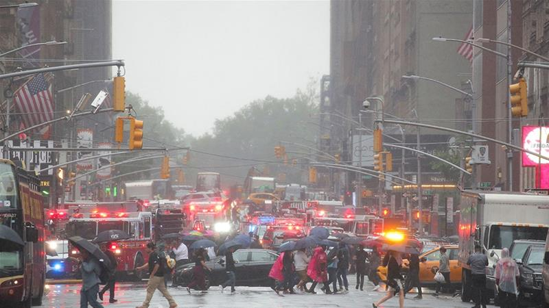 Emergency vehicles fill the street at the scene after a helicopter crashed atop a building in Times Square and caused a fire in the Manhattan borough of New York, New York [Brendan McDermid/Reuters]