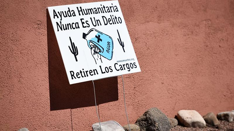 A yard sign in support of 'No Mas Muertes/No More Deaths' is displayed in the neighborhood surrounding the Evo A DeConcini US Courthouse, where humanitarian volunteer Scott Warren faced charges of harboring, and conspiracy to transport undocumented migrants in Tucson, Arizona [Caitlin O'Hara/Reuters]