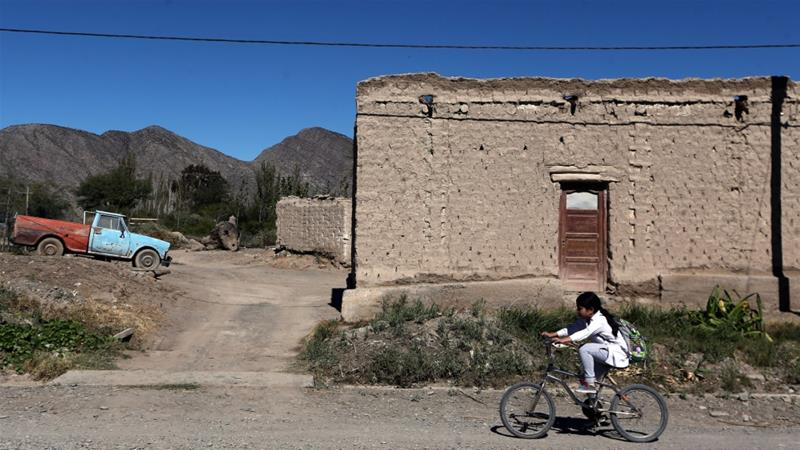 A girl rides her bicycle in Jachal, Argentina, a town that may have been affected by the cyanide spill at the nearby Barrick Gold Corp''s Veladero gold mine [Marcos Brindicci/Reuters]
