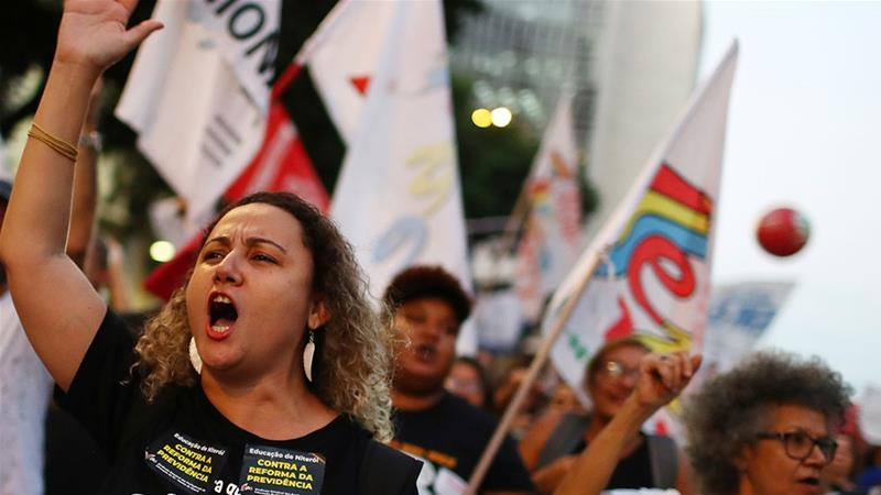 Brazilian protesters clash with police over pension reforms and education cuts