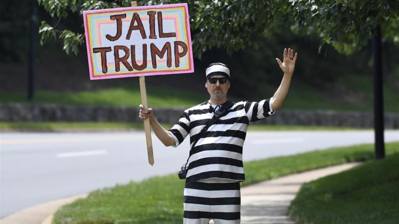 A protesters stands outside the Trump National Golf Club in Sterling, Virginia, as he waits for President Trump to depart on June 16, 2019 [AP/Susan Walsh]