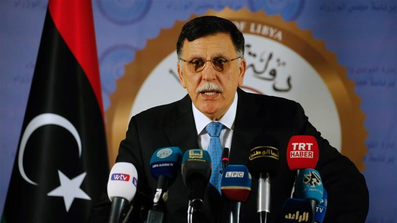 Fayez al-Sarraj proposes forming a Libyan congress as a peaceful solution to the conflict [Mahmud Turkia/ AFP]