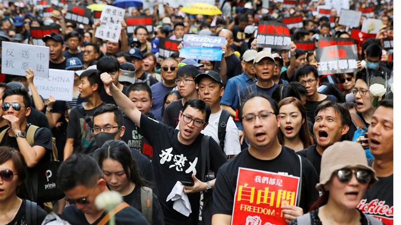 Hong Kong's umbrella activist heads straight to street rallies after prison release