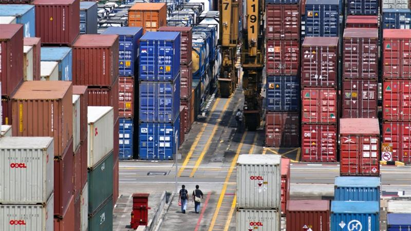 Singapore's exports fell in May the most since March 2016, as demand slumped from China, which is dealing with a trade war with the US [Sam Kang Li/AP]
