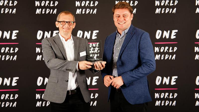 Journalist-photographer Marc Ellison receiving the award in London on Monday evening [One Media World]
