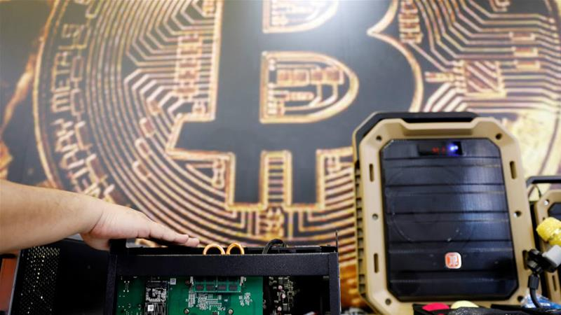 There is growing concern among international law enforcement agencies that cryptocurrencies are being used to launder the proceeds of crime [File: Tyrone Siu/Reuters]