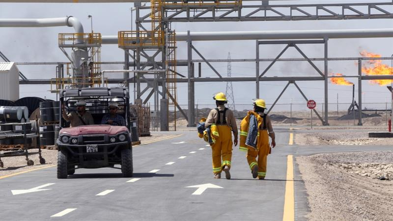 Exxon staff ply their trade at West Qurna-1 oilfield near Basra on Monday [File: Essam al-Sudani/Reuters]