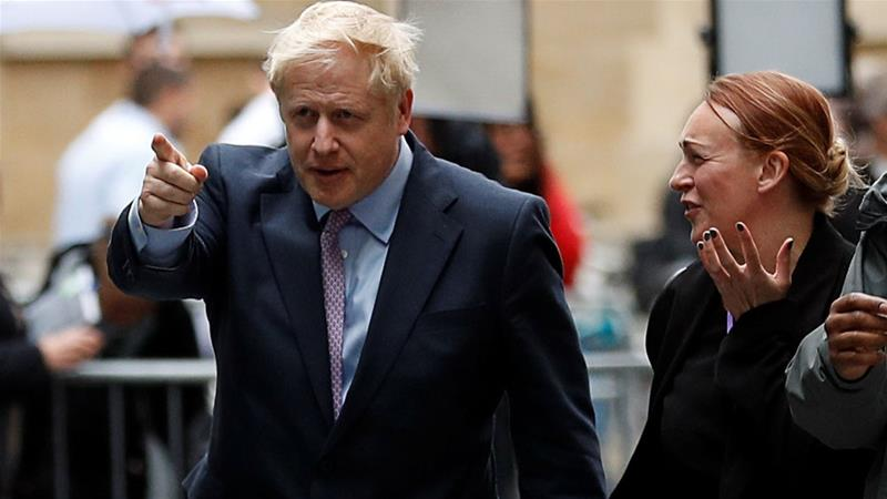 Boris Johnson arrives for a TV debate with candidates campaigning to replace British Prime Minister Theresa May, in London, Britain [Peter Nicholls/Reuters]