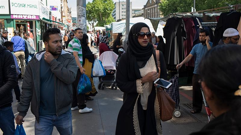People from various ethnic backgrounds around the market on Whitechapel High Street in East London, United Kingdom [File: Mike Kemp/In Pictures via Getty Images]