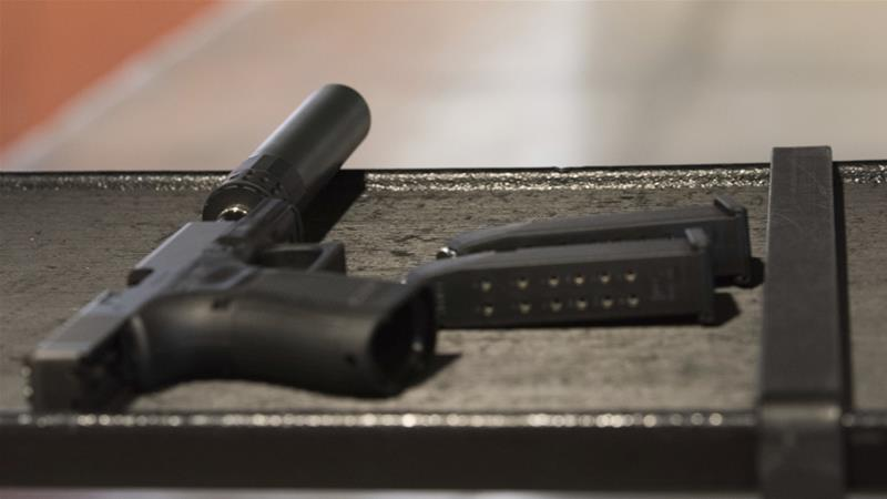 Buying a silencer in the US requires a background check that can take up to eight months [Lisa Marie Pane/AP]