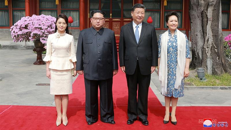 Chinese President Xi Jinping is in North Korea for two days from Thursday, the first Chinese leader to visit in 14 years. Kim has made four visits to China since March 2018, most recently in January. [KCNA/via Reuters]