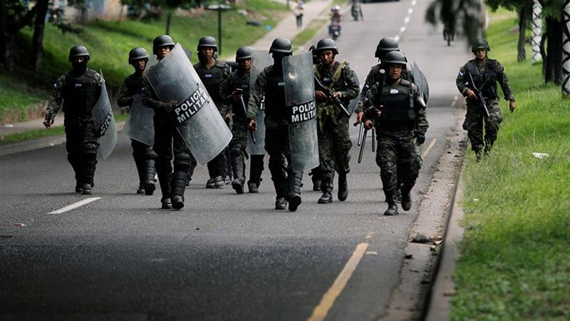 Members of the military police prepare to remove barricades during a protest against the government of Honduras'' President Juan Orlando Hernandez, in Tegucigalpa, Honduras  [Jorge Cabrera/Reuters]