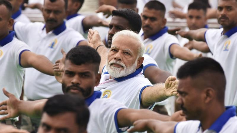India's PM Narendra Modi performs yoga on International Yoga Day in Ranchi city [Rajesh Kumar/Reuters]