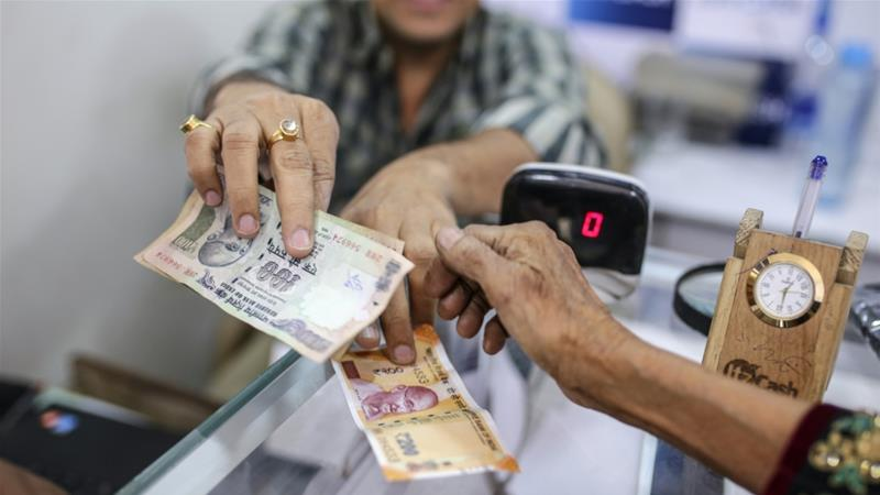 The Indian government has opened hundreds of millions of bank accounts for people in recent years, but many still aren't using them [File: Dhiraj Singh/Bloomberg]