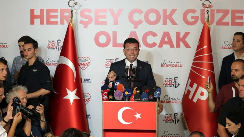 Ekrem Imamoglu declared victory after initial results showed he won a clear majority [Huseyin Aldemir/Reuters]
