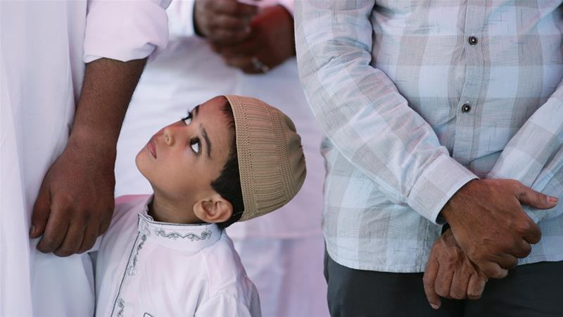 A Muslim boy looks on during Eid al-Fitr prayers in the southern city of Chennai [P Ravikumar/Reuters]