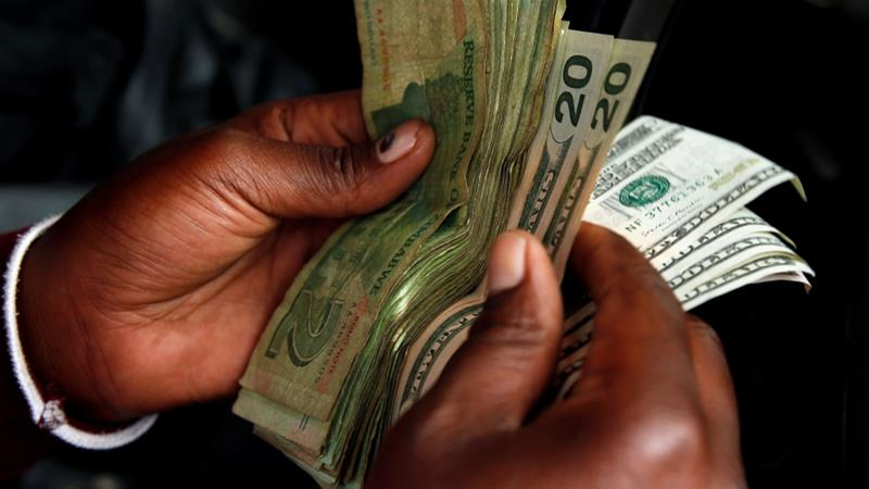 Zimbabwe bans use of US Dollar and Rand
