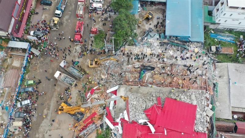 An overhead view of the collapsed under-construction building in Sihanoukville [Reuters]