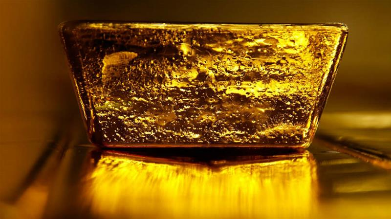 A 12.5kg gold bullion bar sits at a precious metal refinery in Switzerland [Bloomberg Creative Photos]