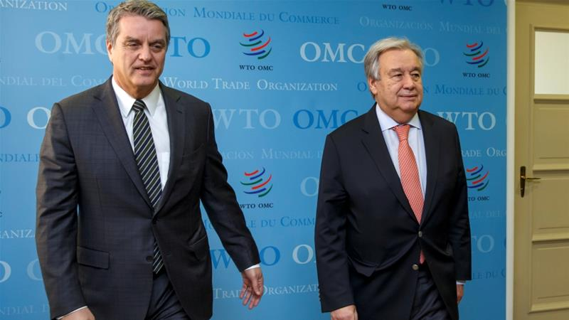 WTO Director-General Roberto Azevedo and United Nations Secretary-General Antonio Guterres meet at the WTO, where the US can still wield its veto over trade-court appointments [Salvatore Di Nolfi/Reuters]